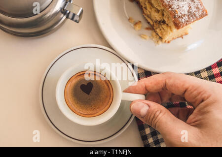 Personal view of a cup of coffee with a heart shape - Stock Photo