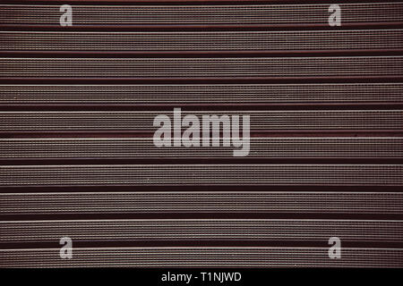 Metal grill with a rubber textured coating brown color.Texture.Background. - Stock Photo