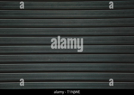 Metal grill with a rubber textured coating in black.Texture.Background. - Stock Photo