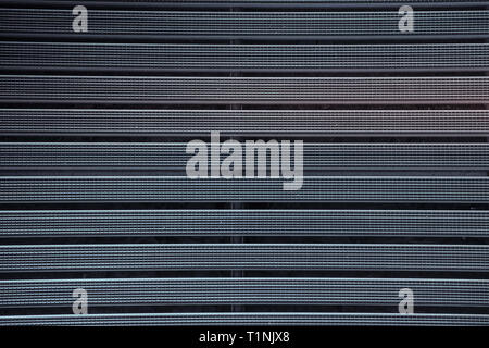 Metal grill with a rubber textured coating purple color.Texture.Background. - Stock Photo