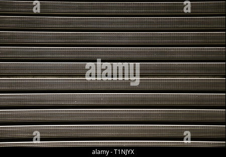 Metal grill with a rubber textured coating brown color.Texture. - Stock Photo