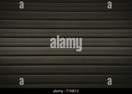 Metal grill with a rubber textured coating brown color.Background. - Stock Photo