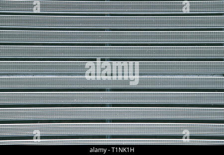 Metal grill with a rubber textured coating grey color.Texture.Background. - Stock Photo