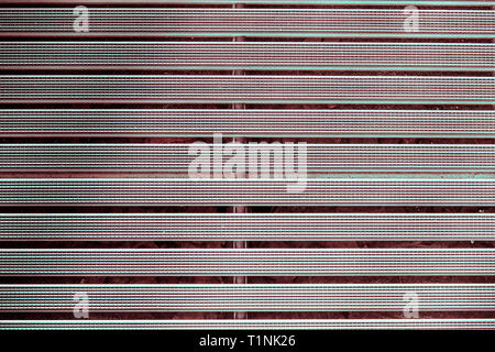 Metal grill with a rubber textured coating grey color.Background. - Stock Photo