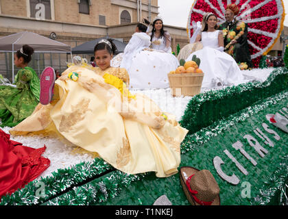 'Royalty' ride on citrus-themed float celebrating the area grapefruit industry during a three-hour parade through Laredo, Texas. - Stock Photo