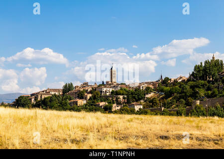 View of Segovia Old Town in Summer from the field next to Iglesia de la Vera Cruz, an ancient Templar church. Castilla Y Leon, Spain - Stock Photo