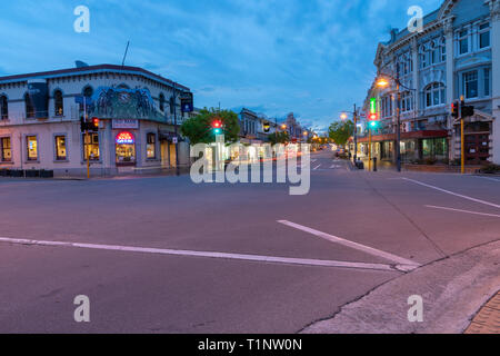 TIMARU NEW ZEALAND - OCTOBER 24 2018; Night city lights, buildings car headlights light trails from passing vehicles intersection with Old Bank - Stock Photo