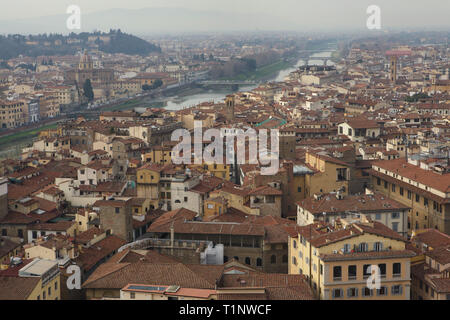 Florence downtown and the Arno River pictured from the rooftop terrace of the Palazzo Vecchio in Florence, Tuscany, Italy. - Stock Photo