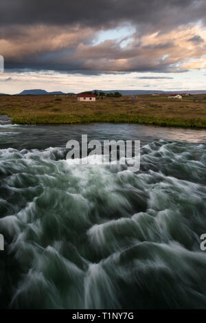 Lonely House at coastline in East Iceland. - Stock Photo
