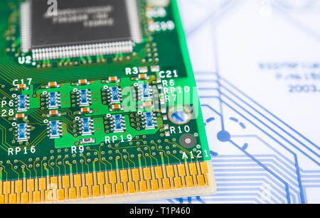 Surface-mount technology. Green circuit board. Old computer processor detail. Blue PCB on plastic keyboard membrane. Electronic components. Retro CPU. - Stock Photo