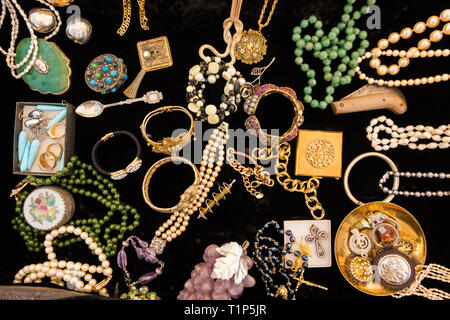 Golden vintage colorful jewelery on black velvet. - Stock Photo