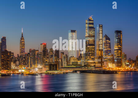 The mixed-use Hudson Yards real estate development and other buildings on the West Side of Manhattan in New York City at dawn. - Stock Photo