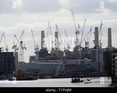 View of the many cranes filling the skyline at the development of Battersea Power Station in London - Stock Photo