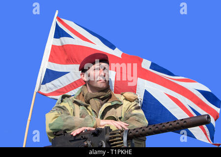 A soldier of the 1st Airborne Division of the British Parachute Regiment with a Browning .30 Calibre during D-Day celebrations in Normandy, France - Stock Photo