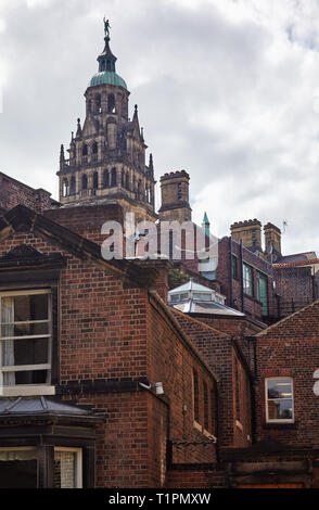 The view of the Town Hall clock tower rising over the old surrounding residential houses. Sheffield. England - Stock Photo