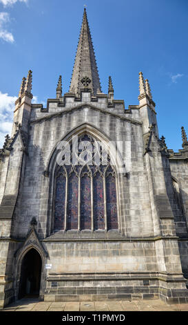The view of the late decorated tracery window at the north transept of Cathedral Church of St Peter and St Paul. Sheffield. England - Stock Photo