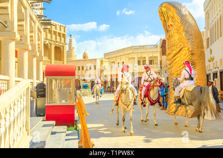Doha, Qatar - February 20, 2019: police officers, famous attraction, riding white Arabian horses at Souq Waqif. Fanar Islamic Cultural Center with - Stock Photo