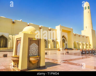 Doha, Qatar - February 21, 2019: drinking fountains outdoor of State Grand Mosque with a minaret on a suny day. Doha mosque in Downtown, Qatar, Middle - Stock Photo