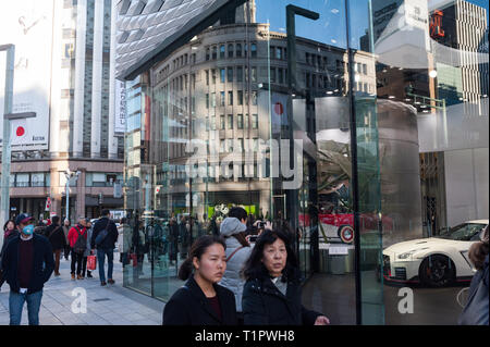 01.01.2018, Tokyo, Japan, Asia - Street scene with pedestrians and retail stores along Chuo-Dori Avenue in the Ginza district of Japan's capital city. - Stock Photo