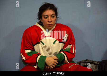 "Macarena Cruz Ceballos, 23, one of the defender of the Selección femenil de México de hockey sobre hielo, sitting in the locker room after a match at the Winter Sports Center Metepec in Metepec, State of Mexico, Mexico on February 15, 2019. The team played against the Buffalos Metepec in the ""Midget"" Hockey League, the score was 3-3. Macarena lives with her parents in San Jerónimo Lídice, an affluent residential neighborhood in Mexico City. Her brother lives in Canada, where he plays ice hockey in the Junior League. She studies economics and finance at the Monterrey Institute of Technology, at - Stock Photo"