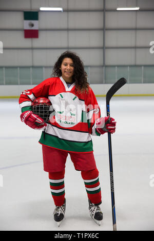 """Portrait of Frida Cárdenas Castro, 21, one of the forwards of the Selección femenil de México de hockey sobre hielo, after a match at the Winter Sports Center Metepec in Metepec, State of Mexico, Mexico on February 15, 2019. The team played against the Buffalos Metepec in the """"Midget"""" Hockey League, the score was 3-3. Frida lives with her family in Doctores, a working class neighborhood in Mexico City. She is in her second year of marketing at the Mexico Anáhuac University, where she has a high performance athlete scholarship. She started roller in-line hockey at age 6 and transitioned to ice  - Stock Photo"""