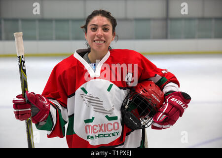 "Portrait of Macarena Cruz Ceballos, 23, one of the defender of the Selección femenil de México de hockey, after a match at the Winter Sports Center Metepec in Metepec, State of Mexico, Mexico on February 15, 2019. The team played against the Buffalos Metepec in the ""Midget"" Hockey League, the score was 3-3. Macarena lives with her parents in San Jerónimo Lídice, an affluent residential neighborhood in Mexico City. Her brother lives in Canada, where he plays ice hockey in the Junior League. She studies economics and finance at the Monterrey Institute of Technology, at the Mexico City campus. Sh - Stock Photo"