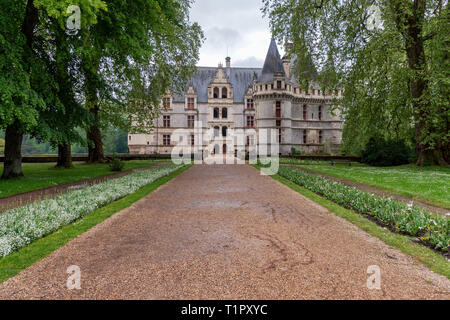 The entrance to Château d'Azay-le-Rideau, in Azay-le-Rideau, Loire Valley, France is across a bridge to an Island in the Indre river. - Stock Photo