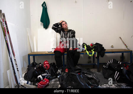 Macarena Cruz Ceballos, 23, one of the defenders of the Selección femenil de México de hockey sobre hielo gets changed in the locker room after a training session at the San Jerónimo ice rink in Mexico City, Mexico on October 2, 2018. The team have trainings every Tuesday and Thursday from 10.30 pm to midnight. Twenty five women and girls from the ages of 16 to 34 train to be drafted in the 19 – strong team that will go to the 2019 IIHF Women's World Championship Division II in Scotland in April 2019. Macarena lives with her parents in San Jerónimo Lídice, an affluent residential neighborhood  - Stock Photo