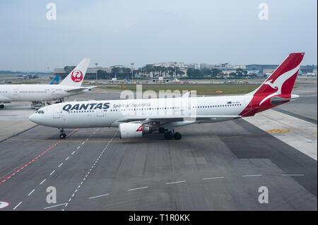 22.03.2019, Singapore, Republic of Singapore, Asia - A Qantas Airways Airbus A330-200 passenger plane at Singapore's Changi Airport. - Stock Photo