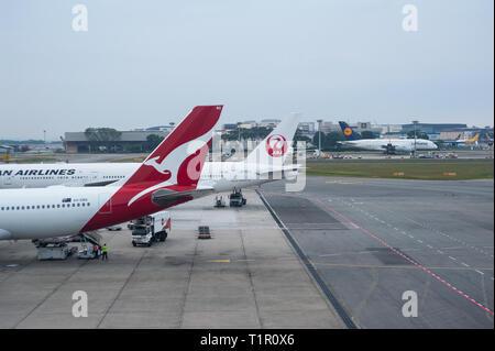 22.03.2019, Singapore, Republic of Singapore, Asia - Qantas Airways and Japan Airlines passenger planes at Singapore's Changi Airport. - Stock Photo