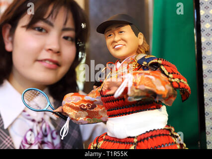 Tokyo, Japan. 28th Mar, 2019. Japanese doll maker Kyugetsu unveils a samurai doll of female professional tennis player Naomi Osaka who won the U.S. Open and Australian Open tennis championships at the company's showroom in Tokyo on Thursday, March 28, 2019 to celebrate the Children's Day on May 5. In Japanese tradition, parents decorate samurai dolls with the earnest wish that their children may grow up to be healthy and robust. Credit: Yoshio Tsunoda/AFLO/Alamy Live News - Stock Photo