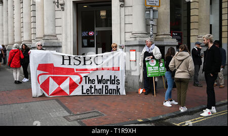 Brighton, UK. 28th Mar, 2019. The Brighton and Hove Palestine Solidarity Campaign outside the HSBC bank in North Street Brighton today . The Stop Arming Israel campaign is hoping to put pressure on the bank to cut ties with companies allegedly supplying weapons to Israel Credit: Simon Dack/Alamy Live News - Stock Photo