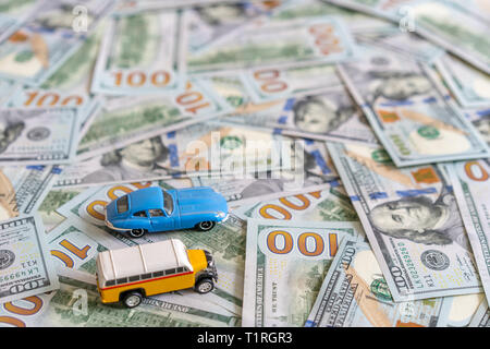 two toys cars on money american banknote background - Stock Photo