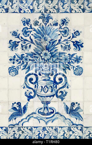 Detail of a traditional tiled wall representing a vase with flowers and two birds in blue and white, seen in the Palacio Real of Coimbra (Portugal). - Stock Photo