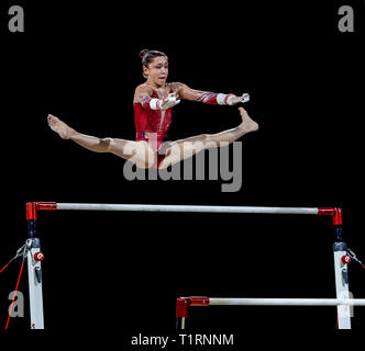 22.03.2019. Resorts World Arena, Birmingham, England. The Gymnastics World Cup 2019 Carolann HEDUIT (FRA) during the Womens uneven bars with a score o - Stock Photo