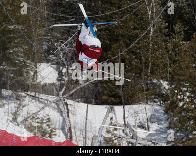 Quebec,Canada .Freestyle Canada ,Brayden Kuroda of the BC Mogul team competes at the National Freestyle Moguls Championship at Val Saint-Come - Stock Photo