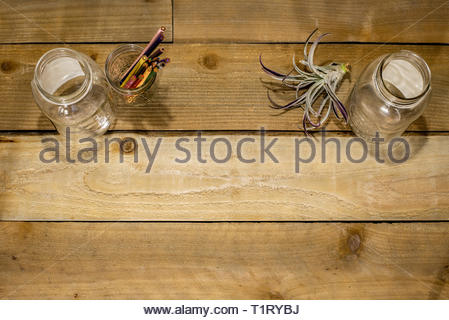 Colored pencils in mason jars. Table top craft area. - Stock Photo