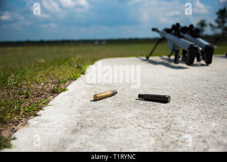 Coast Guard Helicopter Interdiction Tactical Squadron (HITRON) rifles and shells lay at rest May 9, 2018, at Camp Blanding in Starke, Florida. HITRON is an armed United States Coast Guard helicopter squadron specializing in Airborne Use of Force (AUF) and drug-interdiction missions. (U.S. Coast Guard Petty Officer 3rd Class Ryan Dickinson) - Stock Photo