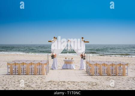 A simple beach wedding arch in Gulf Shores, Alabama - Stock Photo