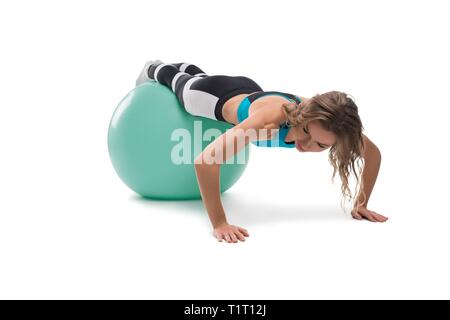 Blonde doing fitness on fitball isolated shot - Stock Photo