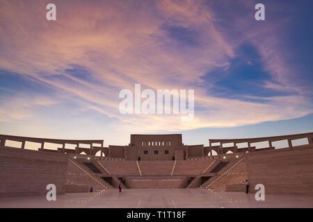DOHA, QATAR – AUGUST 13, 2013: Sunset view of Katara amphitheater in Doha Qatar - Stock Photo