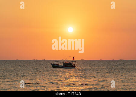 Traditional Vietnamese fishing boats at sunset in the Gulf of Thailand, off Bai Vung Ban beach near Rock island, Phu Quoc, Vietnam, Asia - Stock Photo