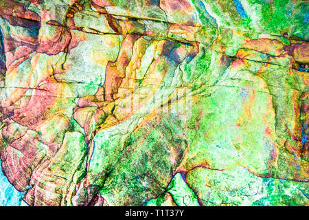 Green, red, orange sediments and minerals, rock formations - a colorful rocks stacked over the hundreds of years - Stock Photo