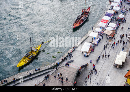 Porto, Portugal - December 2018: Topside view of the Cais da Ribeira, with Rabelo boats and Christmas Market. - Stock Photo