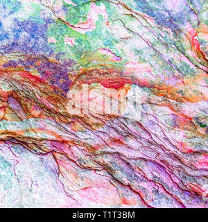 Green, purple, blue sediments and minerals, rock formations - a colorful rocks stacked over the hundreds of years - Stock Photo