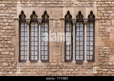 Two windows in a row on the facade of the urban historic building front view, Barcelona, Spain