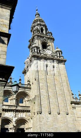 Cathedral, Platerias romanesque facade, baroque clock tower and streetlight. Santiago de Compostela, Spain.