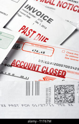 still life of overdue bills with 'final Notice', 'past due' and 'account closed' stamped on them - Stock Photo