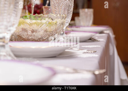 Festive table setting with crystal glasses - Stock Photo