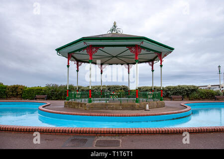 Paddling pool with bandstand on the promenade in Lytham St Annes Lancashire UK - Stock Photo